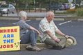 Where are the jobs moral monday rally sign asheville north carolina usa august senior couple sit in a parking lot after a with a Royalty Free Stock Images