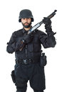 Where are the terrorists a swat agent wearing a bulletproof vest and aiming with a gun Royalty Free Stock Photos