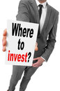 Where to invest businessman showing a signboard with the text written in it Royalty Free Stock Photography