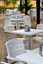 Whie plastic chairs and tables on the patio Royalty Free Stock Photo