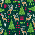Whimsical christmas pattern with reindeer and pine trees Stock Image