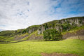 Whin sill at holwick this splendid escarpment known as the scar is part of the in teesdale and popular with climbers Royalty Free Stock Images