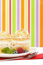 Whipped cream cake garnished with berries Royalty Free Stock Image