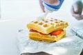 Whipped cream put on belgian waffles Royalty Free Stock Photo