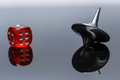 Whirligig and dice with reflection on a dark background Stock Photography