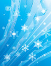 Whirling snowflakes on a blue background Royalty Free Stock Photo
