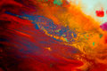 Whirlwind vortex spreads colored ink colors on a white background Royalty Free Stock Photo