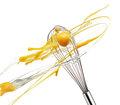 Whisk with eggs Royalty Free Stock Photo