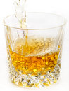 Whiskey being poured Royalty Free Stock Images