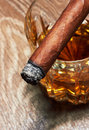 Whiskey and cigar on black background Stock Photography