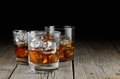 Whiskey close up of glasses of on a wood background Royalty Free Stock Image