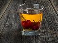 Whiskey cocktail with cherries manhattan or other submerged Stock Photos