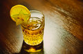 Whiskey a cup of with lemon Royalty Free Stock Photos