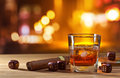 Whiskey and dice on table in bar Stock Photography