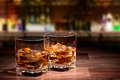 Whiskey drinks on wooden table Royalty Free Stock Images