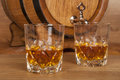 Whiskey glass of and barrel Royalty Free Stock Photos