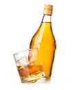 Whiskey glass and bottle of on a white background Royalty Free Stock Photo