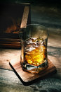 Whiskey glass of with ice on wooden lining and planking texture Stock Photography