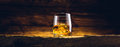Whiskey glass on the old table wooden Stock Photography