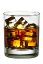 Whiskey with ice cubes in glass Stock Photography