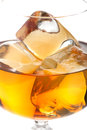 Whiskey with ice cubes in glass closeup Royalty Free Stock Photo