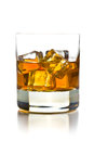 Whiskey with ice in glass on white background Stock Photos