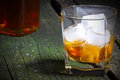 Whiskey with ice on old wood table Royalty Free Stock Photos