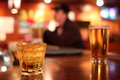 Whiskey rocks glass beer background dive bar Stock Photo