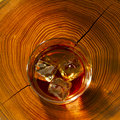 Whiskey on the rocks and wood Royalty Free Stock Photography