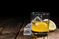 Whiskey sour with ice cubes close up shot Royalty Free Stock Image