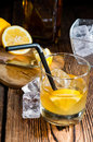 Whiskey sour with ice cubes close up shot Stock Photography