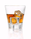Whiskey splash with ice cubes isolated on white Royalty Free Stock Photo