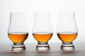 Whiskey in Three Crystal Tasting Glasses Royalty Free Stock Photo