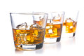 Whiskey three glass of on white background Royalty Free Stock Images