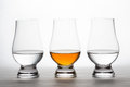 Whiskey and Vodka in Crystal Tasting Glasses Royalty Free Stock Photo