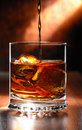 Whisky beeing poured Royalty Free Stock Photo