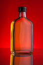 Whisky bottle on red background Stock Photography
