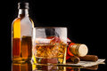 Whisky bottles composition glass and Royalty Free Stock Photos