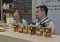 Whisky dram festival in kiev ukraine unrecognized presenters work on the glenrothes speyside single malt scotch distillery booth Royalty Free Stock Photography