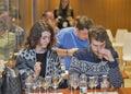 Whisky dram festival in kiev ukraine unrecognized visitors on company presentation smell and taste the glenlivet single malt Royalty Free Stock Photo