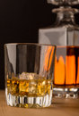 Whisky glass with carafe single malt on the rocks and in background Royalty Free Stock Images