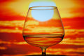 Whisky glass a during a summer with a sunset background Royalty Free Stock Photo