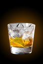 Whisky and lemon cocktail on rocks Royalty Free Stock Photo
