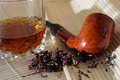 Whisky and the pipe glass of fired smoking are waiting for their master Royalty Free Stock Photography