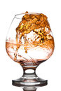 Whisky poured to glass from buttle with splashes Royalty Free Stock Image