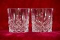 Whisky tumbler glasses on red velvet Royalty Free Stock Photo