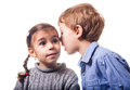 Whisper boy whispering to a girl on white background Stock Images