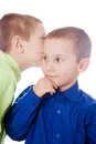 Whispering secrets boys isolated on a white background talking to each other Royalty Free Stock Images
