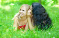 Whispering two girlfriends lying on grass Royalty Free Stock Image
