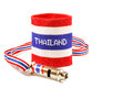 Whistle and wristband in thai flag pattern symbol of resistance to thai government on white background isolated blank area at Stock Photography